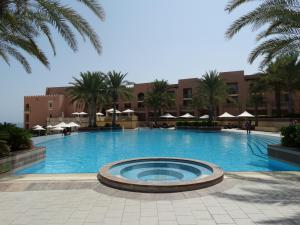 Zwembad van het Al Husn Hotel